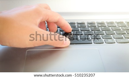 Woman working on notebook computer