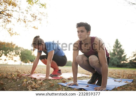 Woman yoga trainer demonstrating to student different positions