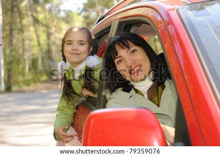 women and girl in auto