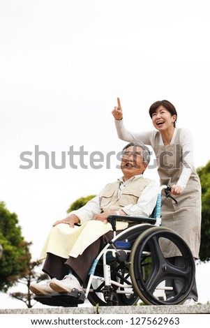 Women assisted wheelchair