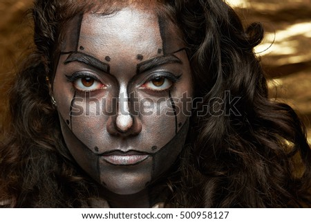 women calm face with body art  of robot on golden background