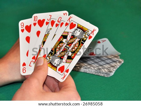 Women hand picking card and collect hearts poker