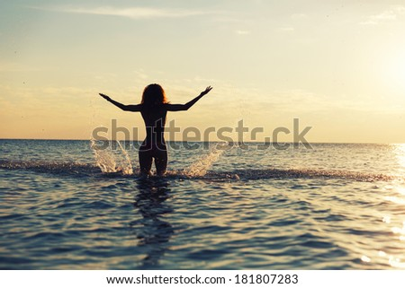 Women in water at sunset