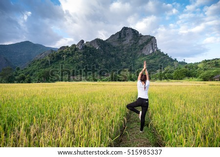women standing exercise in the paddy on mountain background