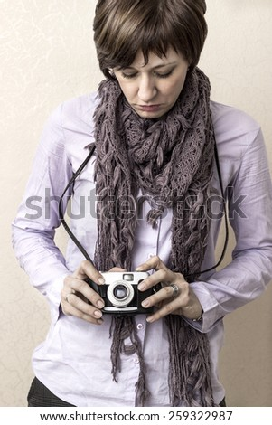 Women with old film camera in hands, close up