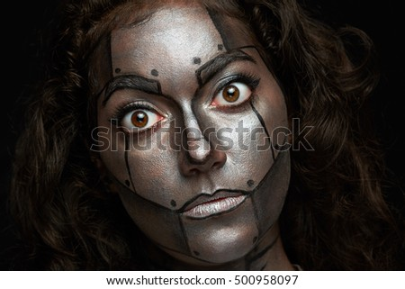 women with round eyes and painted meal robot mask isolated on black