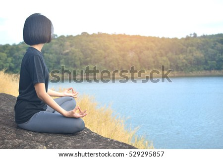 Women yoga in nature near river, color of vintage tone