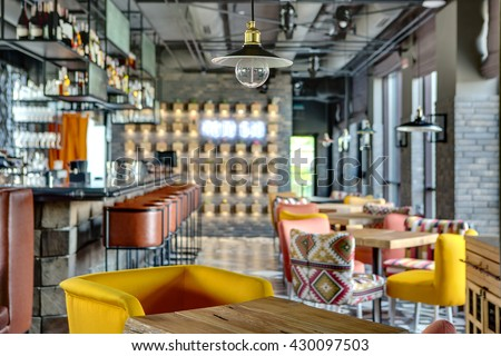 Mexican Restaurant Kitchen Equipment halflighted hall loft style mexican restaurant stock photo