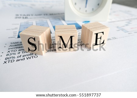 wood blocks with word sme on office table