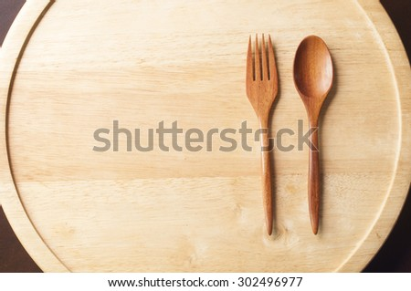 wood cutlery on wooden background.