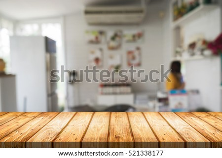 wood desk space and blurred of kitchen background for product display montage business