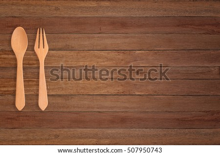 wood spoon on wood background.