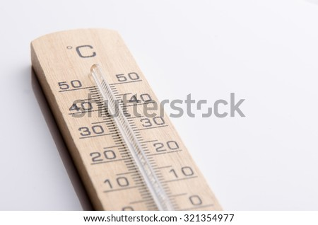 Wood thermometer for measuring the temperature outside.