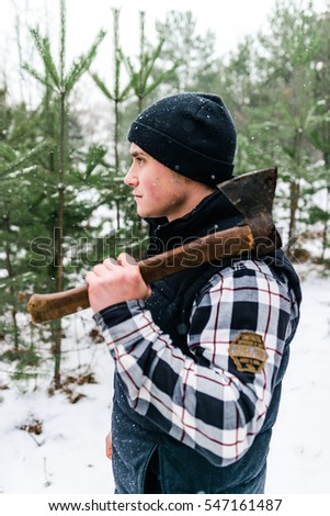 woodcutter in a pine forest