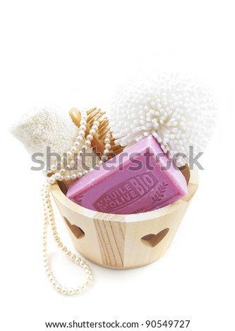 Wooden box filled with body products over white