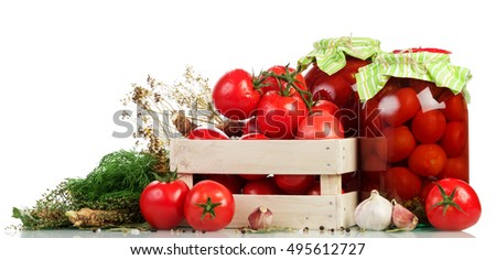 Wooden box of fresh tomatoes, jars of pickled and red pepper isolated on white background.