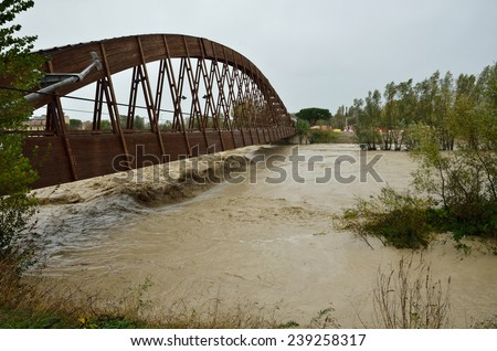wooden bridge over the river in flood