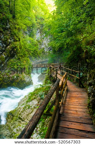 wooden bridges, mountain river flowing fast through the gorge, vintgar, bled, slovenia