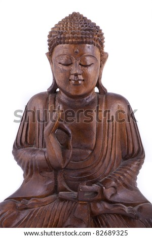 Wooden Buddha statue on white background, with eyes closed