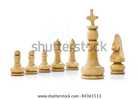 Wooden chess team on white background
