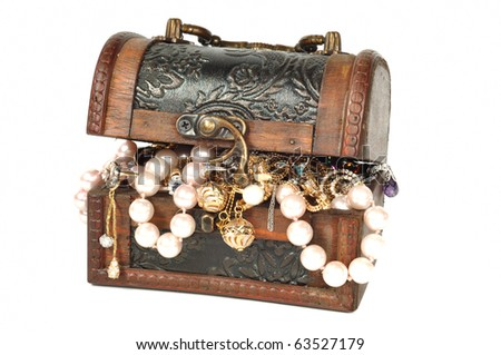 Wooden chest with pearls and gold , isolated on white