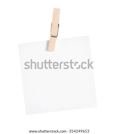 Wooden clothespin and blank paper on white background.