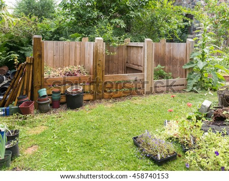 wooden compost bins in garden setting