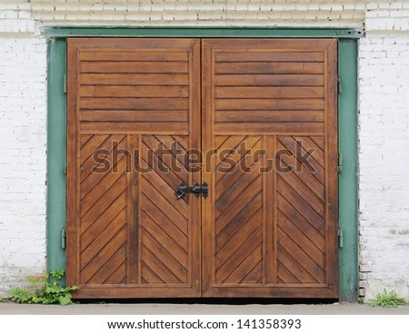 Wooden door on a brick garage