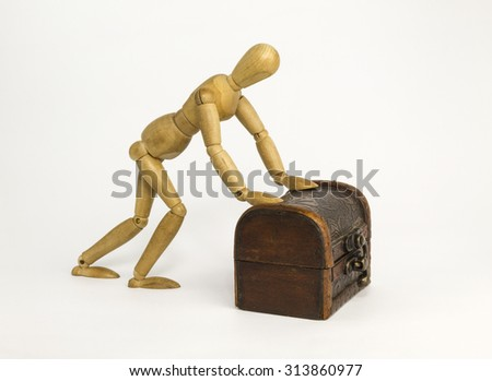 Wooden dummy man pushing a dower chest