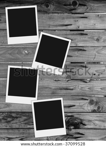 wooden fence with rusty nails and blank photos