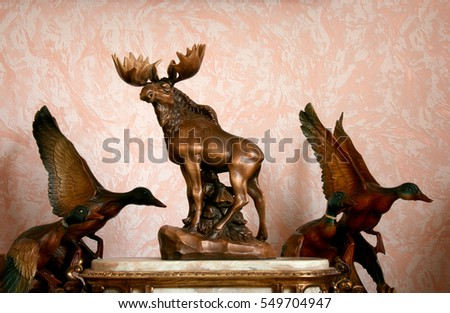 Wooden figurines of elk and mallards