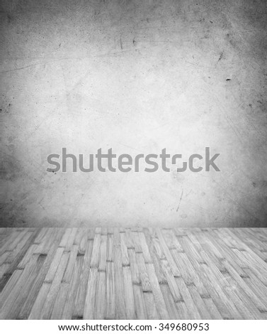 Wooden floorboards and blank wall