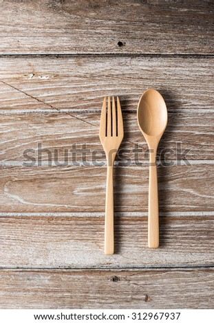 wooden fork on wood background
