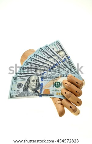 wooden hand holding money isolated on white
