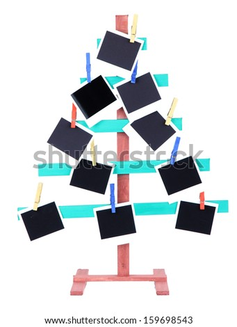 Wooden hand made fir tree with empty photo paper, isolated on white