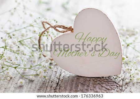 wooden heart shape with text and white flowers for mothers day