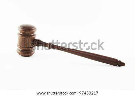 Wooden judge hammer isolated on white background