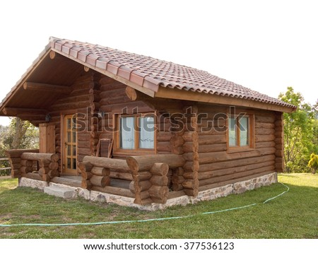 Wooden log house with lawn in the country