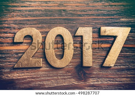 Wooden numbers forming the number 2017, as the new year on a rustic wooden surface