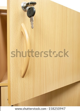 wooden office cupboard with keys hanging