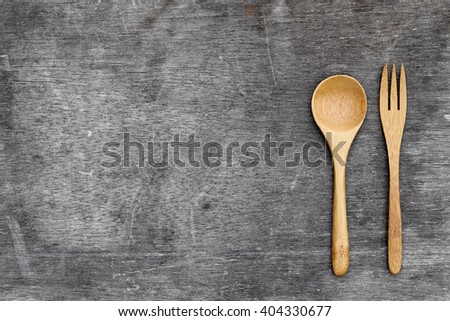 wooden spoon and fork on grunge wooded table background