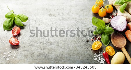 Wooden spoon and ingredients on old background. Vegetarian food, health or cooking concept.  Background layout with free text space.