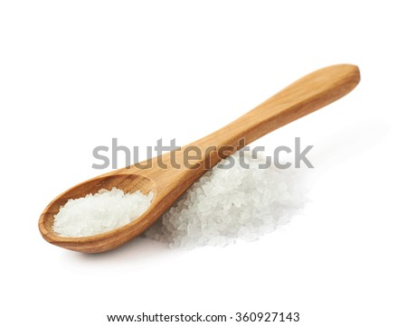 Wooden spoon over the salt