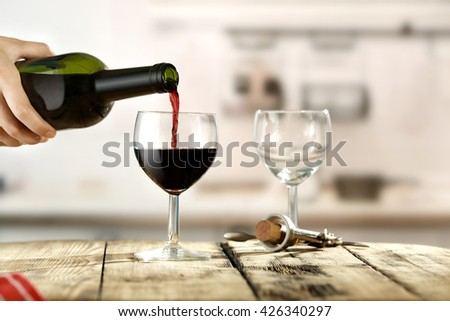 Wooden Table Glasses Of Wine And Bottle