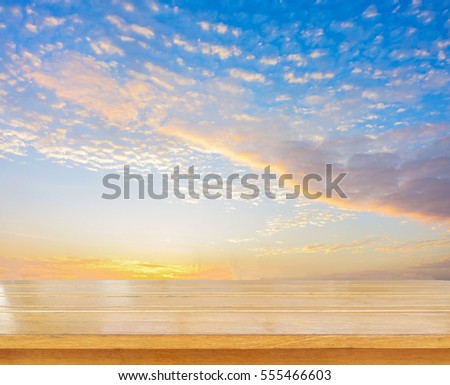 Wooden tabletop use for products or something display with blue sky on sunset background