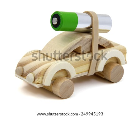 Wooden toy car with a double A battery strapped to the top.