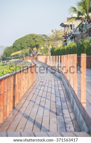 Wooden walk way at the river. (Selective Focus)