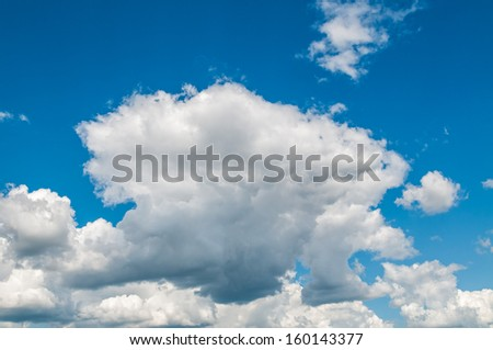 Wool-pack clouds  in blue sky