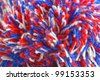 Wool yarn ends from bobble hat, closeup - stock photo