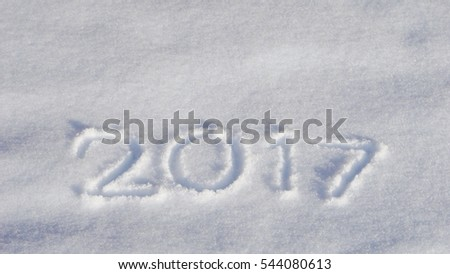 "Word ""2017"" hand drawn in fresh snow background"